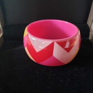 Bright pink fabric and plastic bangle